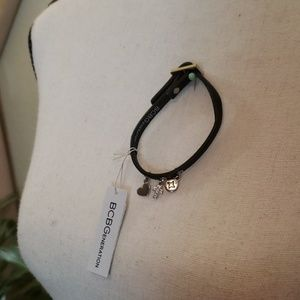 BCBGeneration black bracelet with 3 charms NWT